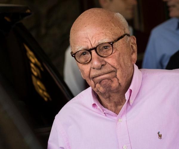 Murdoch, grimacing